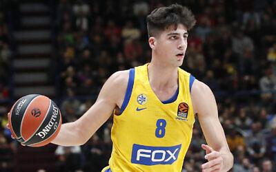 Maccabi Tel Aviv's Deni Avdija controls the ball during the Euro League basketball match between Olimpia Milan and Maccabi Fox Tel Aviv, in Milan, Italy, November 19, 2019. (AP Photo/Antonio Calanni)