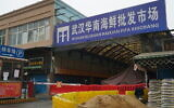 The Wuhan Huanan Wholesale Seafood Market, beleived to be the source of the coronavirus sits closed in Wuhan, China, Tuesday, Jan. 21, 2020.  (AP Photo/Dake Kang)