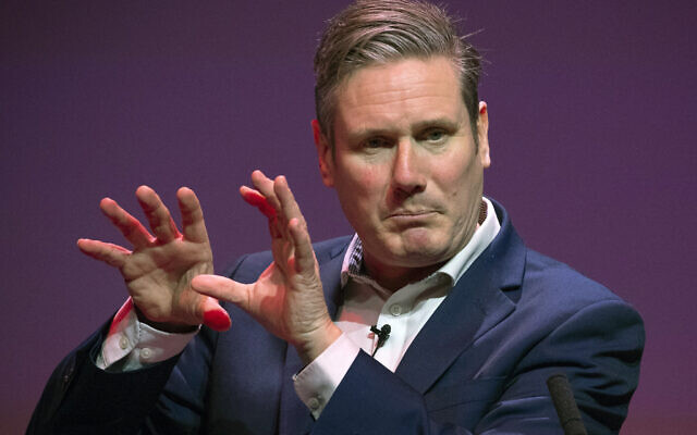 Labour's Keir Starmer gestures, during the Labour leadership hustings at the SEC centre, in Glasgow, Scotland, Saturday, Feb. 15, 2020 (Jane Barlow/PA via AP)