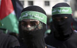 Masked Hamas gunmen march during a protest against the Mideast plan announced by US President Donald Trump,  February 21, 2020.  (AP Photo/Adel Hana)