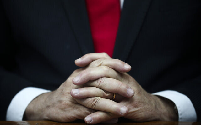 Prime Minister Benjamin Netanyahu's hands clasped as he chairs the weekly cabinet meeting in Jerusalem, March. 8, 2020. (AP Photo/Oded Balilty, Pool)