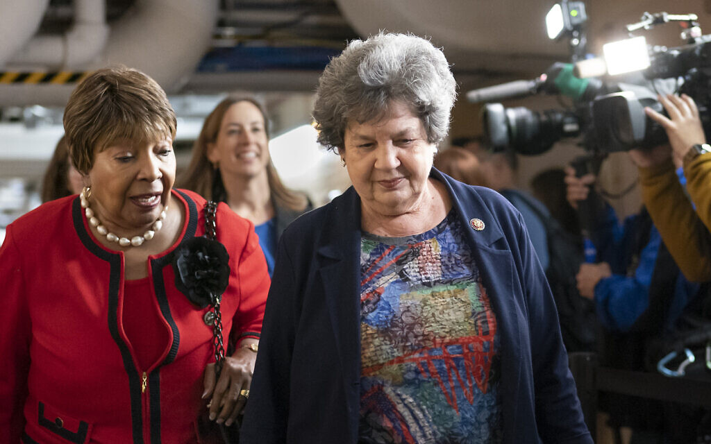 Rep. Eddie Bernice Johnson, D-Texas, chair of the House Science, Space and Technology Committee, left, and Rep. Lois Frankel, D-Fla., on Capitol Hill in Washington, March 11, 2020. (AP Photo/J. Scott Applewhite)