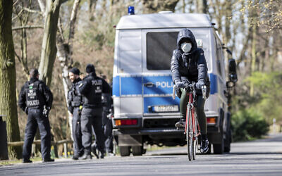 [Illustrative] German police patrol to make sure that the distance regulations are observed during the coronavirus outbreak in Berlin, Germany, Monday, March 23, 2020. (Michael Kappeler/dpa via AP)