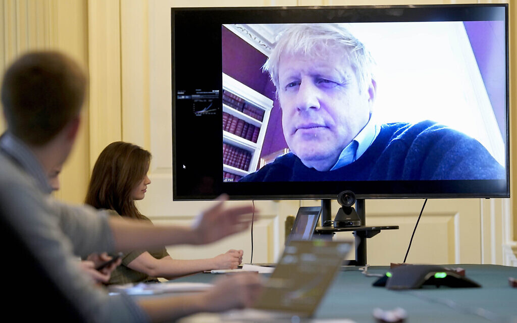 In this handout photo provided by Number 10 Downing Street, Britain's Prime Minister Boris Johnson chairs the morning Covid-19 Meeting remotely after self isolating after testing positive for the coronavirus, at 10 Downing Street, London, March 28, 2020. (Andrew Parsons/10 Downing Street via AP)