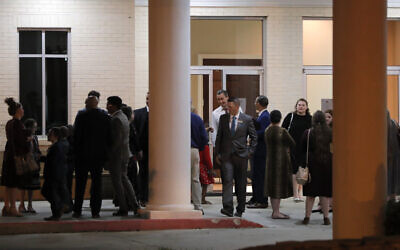 Pastor Tony Spell, center background, talks to congregants after an evening service at Life Tabernacle Church in Central, La., Tuesday, March 31, 2020. (AP/Gerald Herbert)