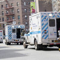 Ambulances line the street outside Elmhurst Hospital Center, in the Queens borough of New York, April 4, 2020. (Mary Altaffer/AP)