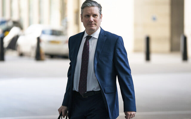 Newly-elected Labour Party leader Keir Starmer arrives at BBC Broadcasting House in London to appear on the Andrew Marr show Sunday, April 5, 2020. Lawyer and lawmaker Starmer was elected leader of Britain's main opposition Labour Party on Saturday, April 4, by a decisive margin, after a contest thrown into turmoil by the coronavirus outbreak.(Aaron Chown/PA via AP)