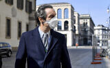 The governor of Region Lombardy, the coronavirus worst-hit region of Italy, Attilio Fontana wears a face mask as he walks in Milan, Italy, April 5, 2020. (Claudio Furlan/LaPresse via AP)