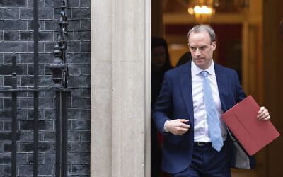 Britain's Foreign Secretary Dominic Raab leaves a meeting in Downing Street, London, Monday April 6, 2020.  Britain's Prime Minister Boris Johnson has been moved to the intensive care unit of a London hospital on Monday, April 6, 2020 after his coronavirus symptoms worsened. Johnson's office says Johnson is conscious and does not require ventilation at the moment.  (Dominic Lipinski/PA via AP)
