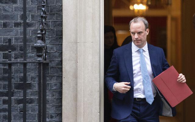 Britain's Foreign Secretary Dominic Raab leaves a meeting in Downing Street, London, April 6, 2020.  (Dominic Lipinski/PA via AP)