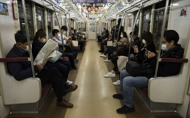 Commuters ride a train in Tokyo, April 7, 2020. (Jae C. Hong/AP)