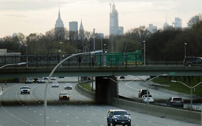 Car driers move on the Grand Central Parkway during rush hour Tuesday, April 7, 2020, in the Queens borough of New York. (AP Photo/Frank Franklin II)