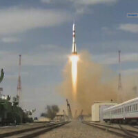 In this grab taken from video footage released by Roscosmos Space Agency,  the Soyuz-2.1a rocket booster with Soyuz MS-16 space ship carrying a new crew to the International Space Station, ISS, blasts off at the Russian leased Baikonur cosmodrome, Kazakhstan, April 9, 2020 (Roscosmos Space Agency via AP)