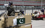 Pakistani soldiers patrol during a government-imposed nationwide lockdown to help contain the spread of coronavirus, in Peshawar, Pakistan, Thursday, April 9, 2020. (AP/Muhammad Sajjad)
