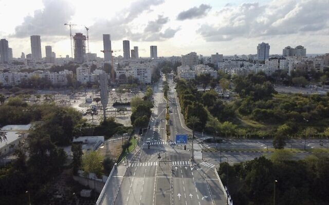 Roads are empty during a lockdown to help stop the spread of the coronavirus, in Tel Aviv, April 9, 2020. (AP Photo/Ariel Schalit)