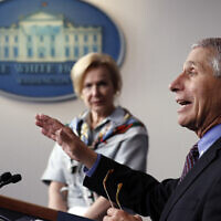 Dr. Anthony Fauci, director of the National Institute of Allergy and Infectious Diseases, speaks about the coronavirus in the James Brady Press Briefing Room of the White House,  April 9, 2020, in Washington, as Dr. Deborah Birx, White House coronavirus response coordinator, listens. (AP Photo/Andrew Harnik)