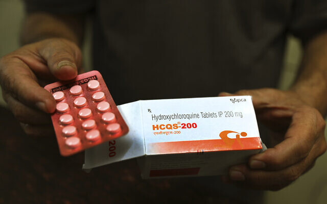 A chemist displays hydroxychloroquine tablets in New Delhi, India, April 9, 2020. AP Photo/Manish Swarup)