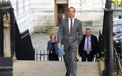 British Foreign Secretary Dominic Raab arrives at Downing Street, London, April 14, 2020 as he stands in for Prime Minister Boris Johnson who is convalescence following his hospitalization with the coronavirus.  (Stefan Rousseau / PA via AP)