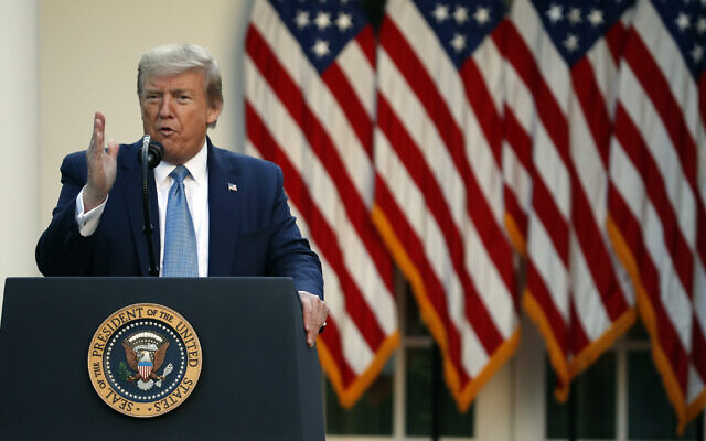 US President Donald Trump speaks about the coronavirus in the Rose Garden of the White House,  April 15, 2020. (AP Photo/Alex Brandon)