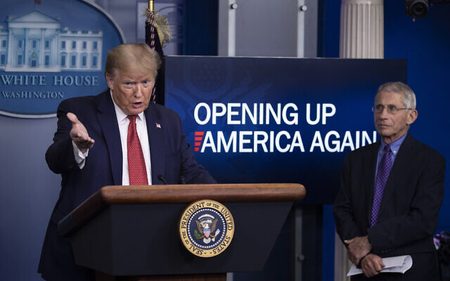US President Donald Trump speaks about the coronavirus, accompanied by Dr. Anthony Fauci, director of the National Institute of Allergy and Infectious Diseases, in the James Brady Press Briefing Room of the White House, Thursday, April 16, 2020, in Washington. (AP Photo/Alex Brandon)