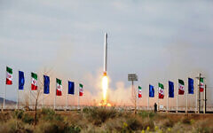 In this photo released on April 22, 2020, by Sepahnews, an Iranian rocket carrying a satellite is launched from an undisclosed site believed to be in Iran's Semnan province. (Sepahnews via AP)