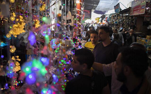 Palestinians shop in the Zawiya market ahead of the Muslim holy month of Ramadan, in Gaza City, April 22, 2020. (AP/Khalil Hamra)