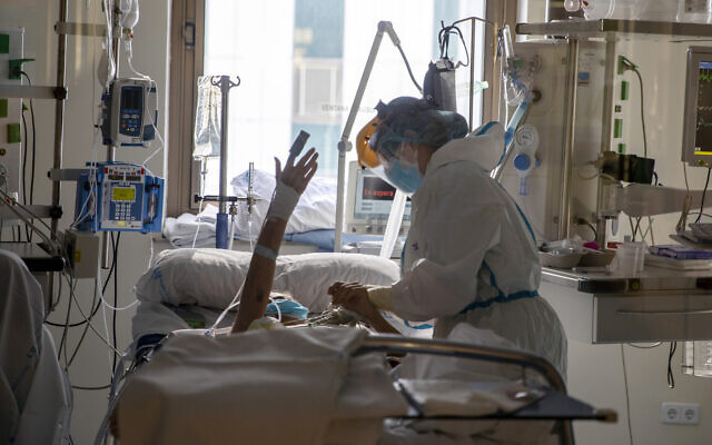 Healthcare workers assist a COVID-19 patient at one of the intensive care units (ICU) of the Ramon y Cajal hospital in Madrid, Spain, on April 24, 2020. (AP Photo/Manu Fernandez)
