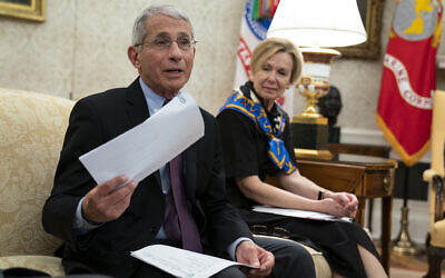 White House coronavirus response coordinator Dr. Deborah Birx listens as director of the National Institute of Allergy and Infectious Diseases Dr. Anthony Fauci speaks during a meeting between President Donald Trump and Gov. John Bel Edwards, D-La., about the coronavirus response, in the Oval Office of the White House, April 29, 2020, in Washington. (AP Photo/Evan Vucci)