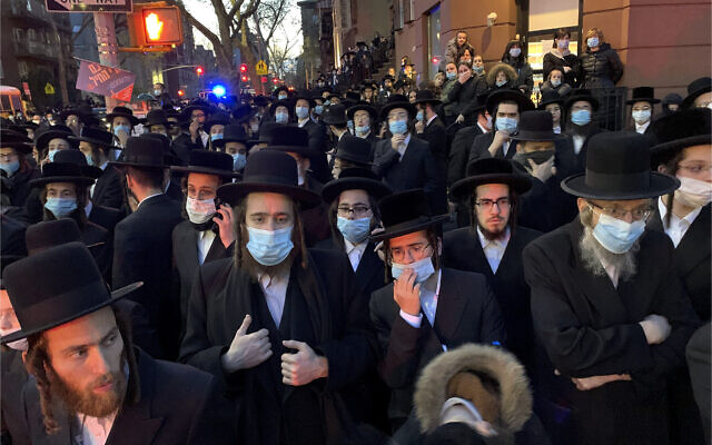 Hundreds of mourners gather in the Brooklyn borough of New York, Tuesday, April 28, 2020, to observe a funeral for Rabbi Chaim Mertz, a Hasidic Orthodox leader whose death was reportedly tied to the coronavirus.(Peter Gerber via AP)