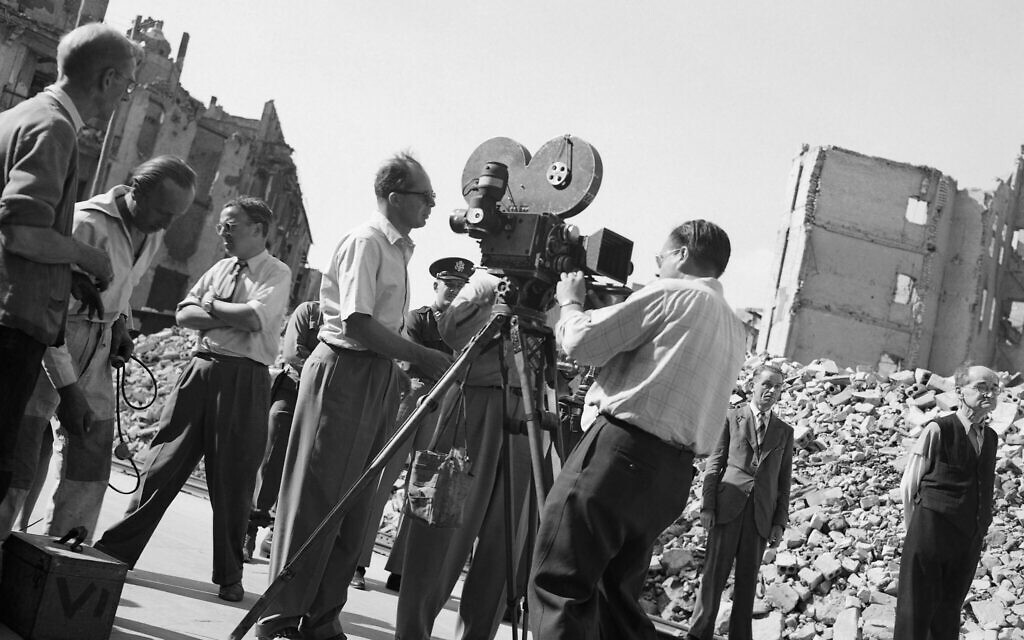 Director of Paramount's 'Foreign Affair' Billy Wilder, left, directs camera crew in shooting background material for the picture in one of Berlin's bombed out streets, August 18, 1947. (AP Photo/Wolfgang Sorsche)