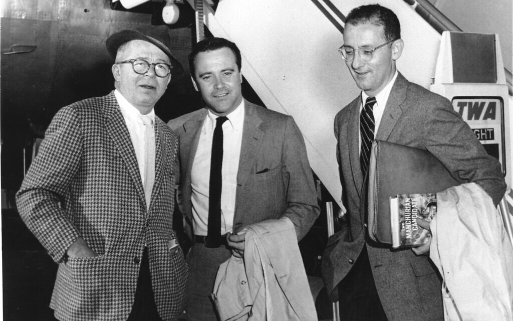 Producer and director Billy Wilder, left, actor Jack Lemmon, center, and writer I.A.L. Diamond are shown arriving at New York's International Airport on May 7, 1959. (AP Photo)