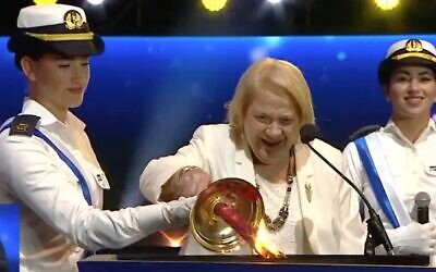 Screen capture of Renee Abitbul, 92, lighting a torch during the annual torch-lighting ceremony at the start of Independence Day, April 28, 2020. (Twitter)
