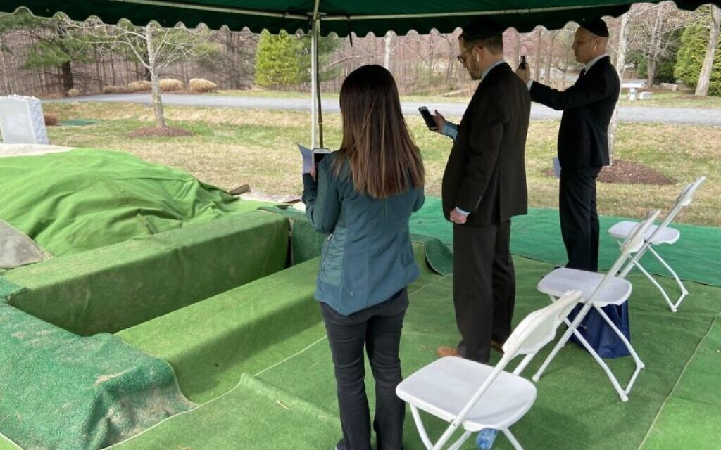 Karen, Mark and Ken Katz bury their mother, Linda Katz, at the Garden of Remembrance in Clarksburg, Maryland, during a Zoom-conducted service on March 23, 2020. (Courtesy/Garden of Remembrance Memorial Park)