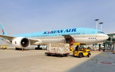 A Korean Air plane carrying chemicals for 100,000 coronavirus tests arrives at Ben Gurion Airport, April 15, 2020 (Courtesy Defense Ministry)