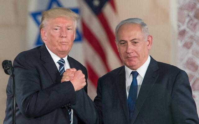 US President Donald Trump and Prime Minister Benjamin Netanyahu shake hands after giving final remarks at the Israel Museum in Jerusalem before Trump departure, on May 23, 2017. Yonatan Sindel/Flash90/File)