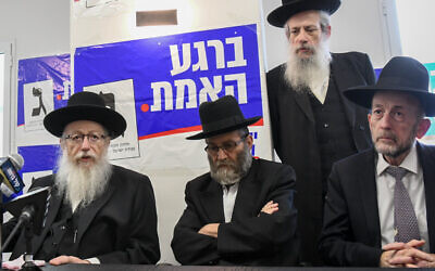 Health Ministe Yaakov Litzman (left) at an election campaign opening event for his United Torah Judaism party in Bnei Brak on May 30, 2019. The party slogan on the banner behind him reads 'At the moment of truth.' (Flash90)
