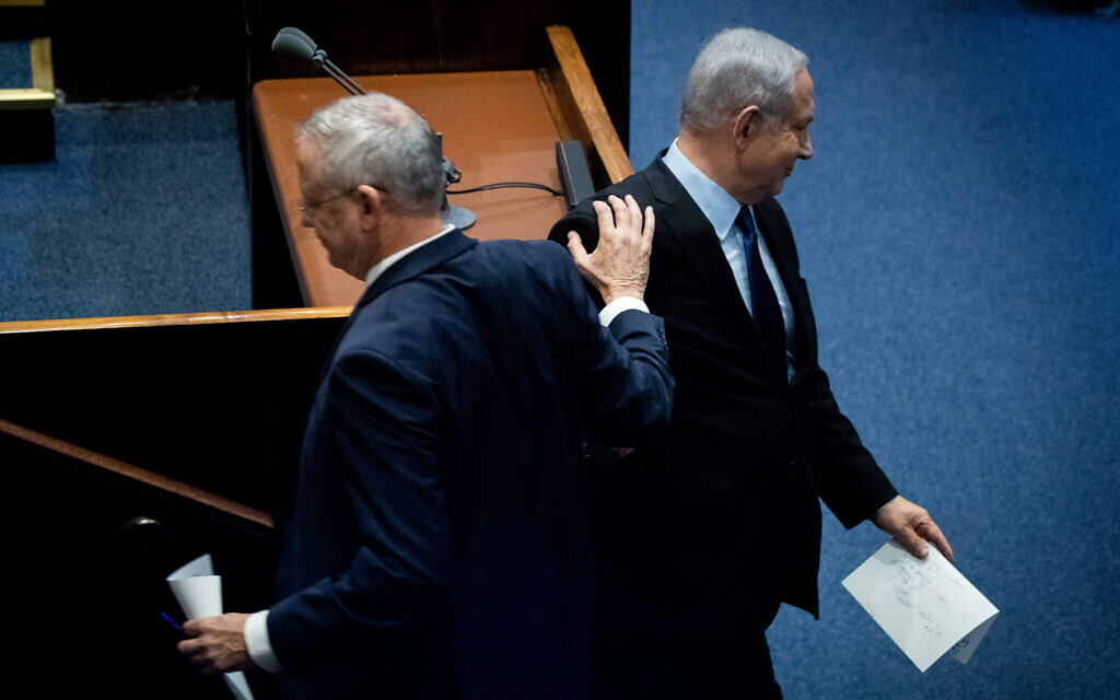Prime Minister Benjamin Netanyahu and Blue and White party leader Benny Gantz at a memorial ceremony marking 24 years since the assassination of prime minister Yitzhak Rabin, in the Knesset, November 10, 2019. (Yonatan Sindel/Flash90)