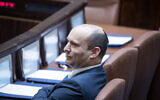 Defense Minister Naftali Bennett of Yamina in the plenum hall of the Knesset on February 10, 2020. (Yonatan Sindel/Flash90)
