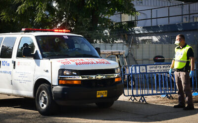Illustrative: An ambulance brings an Israeli man who tested positive for the coronavirus to Sheba Medical Center at Tel Hashomer on February 27, 2020. (Flash90)
