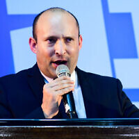 Defense Minister Naftali Bennett at his Yamina party's campaign headquarters in Ramat Gan on March 2, 2020. (Flash90)