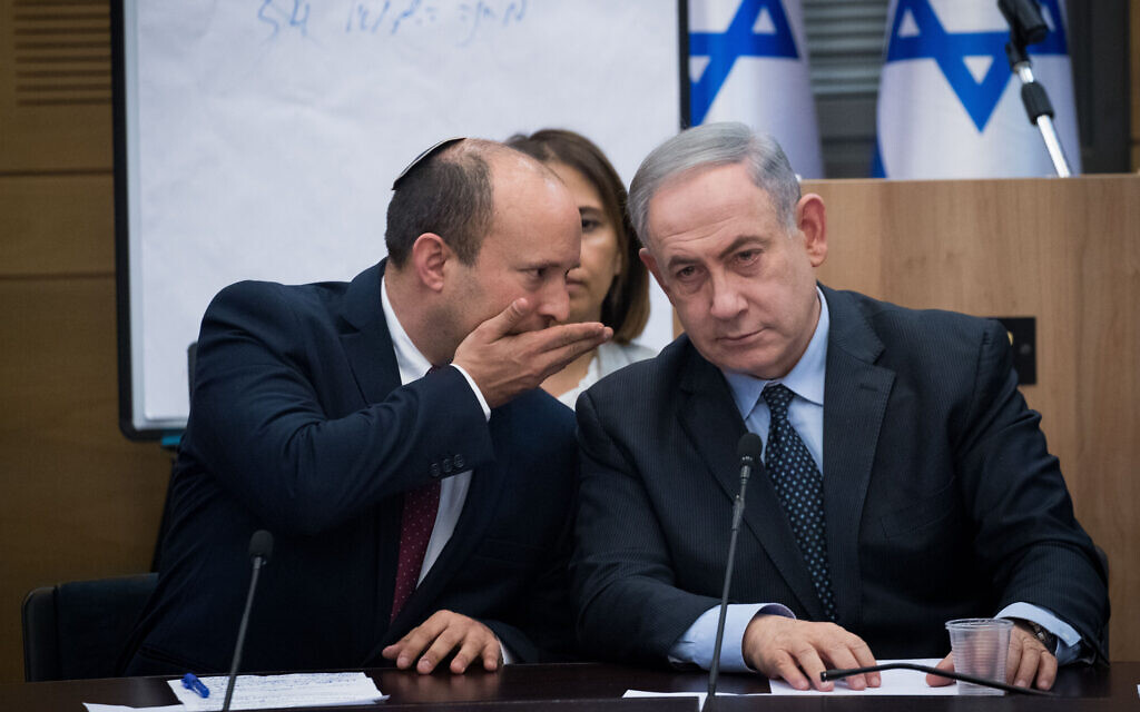 Defense Minister Naftali Bennett (L) of Yamina speaks to Prime Minister Benjamin Netanyahu during a meeting with leaders of right-wing parties at the Knesset in Jerusalem, March 4, 2020. (Yonatan Sindel/Flash90)