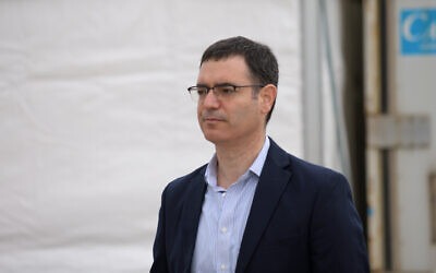 Health Ministry Director General Moshe Bar Siman-Tov is seen at a drive-through site for coronavirus testing samples collection, in Tel Aviv, on March 20, 2020. (Gili Yaari/Flash90)