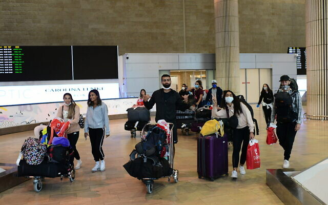 Illustrative photo of Israeli travelers arriving at Ben Gurion airport on March 23, 2020. (Tomer Neuberg/Flash90)
