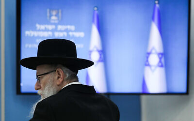 Health Minister Yaakov Litzman at a press conference about the coronavirus at the Prime Ministers Office in Jerusalem on March 25, 2020. (Olivier Fitoussi/Flash90)