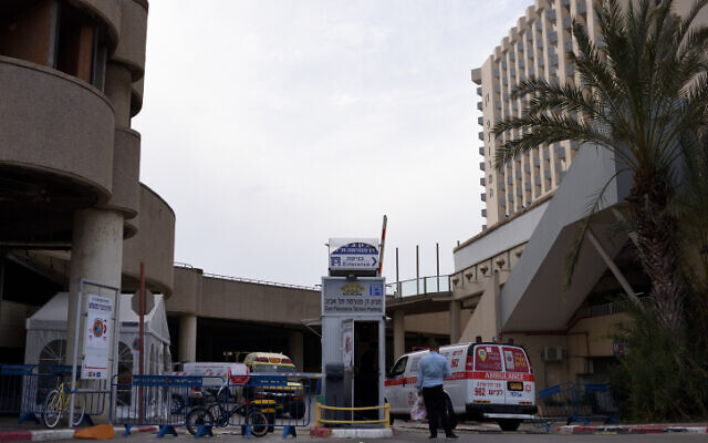 A Magen David Adom ambulance at Tel Aviv's Dan Panorama hotel, which was turned into quarantine facility, on March 26, 2020. (Gili Yaari /Flash90)