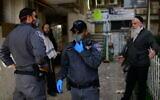 Police patrol in the predominantly ultra-Orthodox city of Bnei Brak on March 30, 2020. (Tomer Neuberg/Flash90)