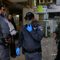 Police patrol in the predominantly ultra-Orthodox city of Bnei Brak on March 30, 2020. (Tomer Neuberg/Flash90)