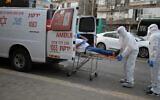 Israeli Magen David Adom medical team members transfer an Israeli man, suspected of being Covid-19 positive, in the Ultra-Orthodox Jewish city of Bnei Brak, March 31, 2020. (Gili Yaari/Flash90)