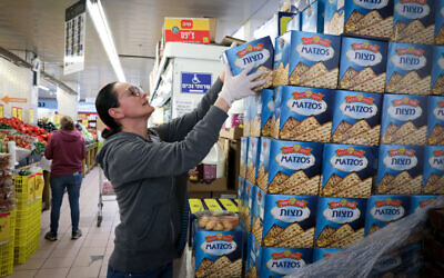 A woman shops for matzah at a supermarket in Jerusalem on March 31, 2020. (Yossi Zamir/Flash90)