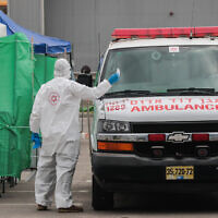 A Magen David Adom ambulance  service testing site in Bnei Brak on April 1, 2020. (Yossi Zamir/Flash90)